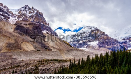 Rugged mountain peaks of The Mitre and Mount Aberdeen surrounding the Hiking Trail to the Plain of Six Glaciers in Banff National Park in the Canadian part of the Rocky Mountains - stock photo