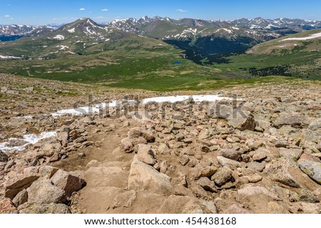 Rugged Mountain Trail - Springtime on a rugged and steep mountain trail, Mount Bierstadt Hiking Trail, in Front Range of Rocky Mountains, Colorado, USA. - stock photo