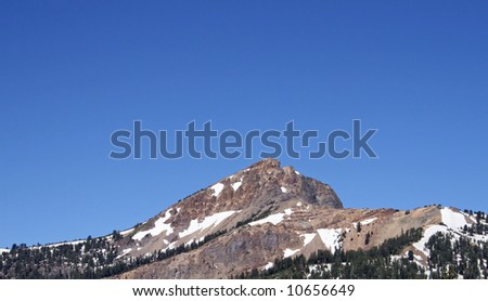 Rugged mountains in the park hold patches of snow all summer long. Lassen Volcanic National Park