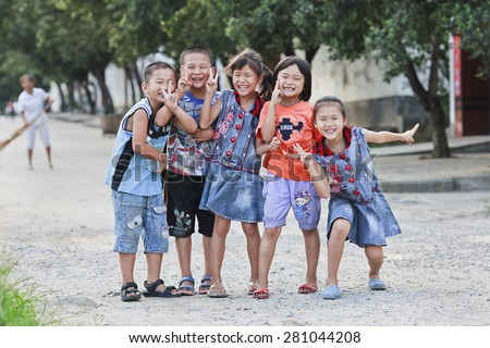 RUILI-CHINA-JUNE 20, 2010. Cheerful group youthful of boys and girls. China's sex ratio between 1985 and 1989 was 108. Today it is over 120, biologically impossible without human intervention. - stock photo