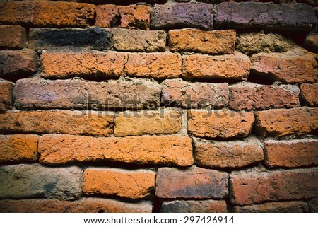 Ruin and ancient orange brick wall surface background texture - stock photo