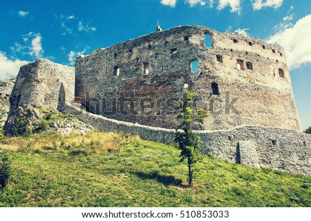 Ruin castle of Topolcany, Slovak republic, central Europe. Ancient architecture. Beautiful place. Retro photo filter. Travel destination.