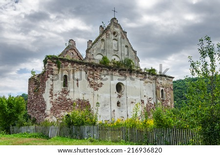 Ruin of a rural medieval church. Abandoned chapel. - stock photo