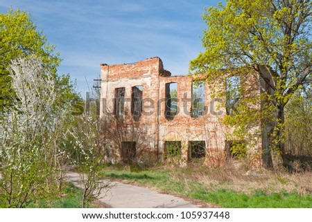 Ruin of the noble house in a typical rural environment - stock photo