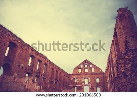 Ruined castle, retro stylized photo - stock photo