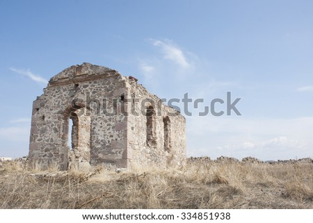 Ruined church on a hill at aegean town  - stock photo