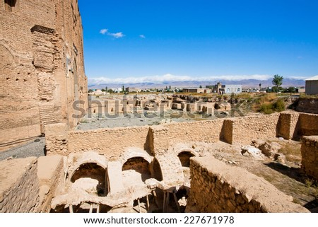 Ruined fortress walls near the Persian mausoleum Dome of Soltaniyeh, became the UNESCO World Heritage site. The stone buildings erected from 1302 to 1312 AD, has the oldest double-shell dome in Iran.  - stock photo