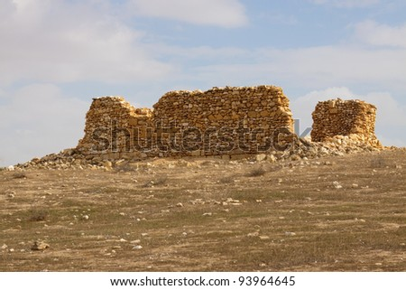 Ruined house in a desert - stock photo