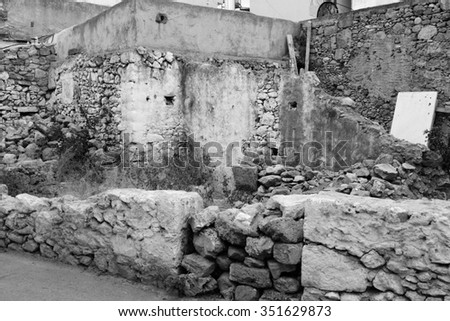 Ruined house in the old part of Malia, Crete, Greece. Black and white.