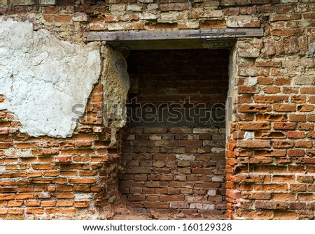 ruined old brick house detail facade - stock photo