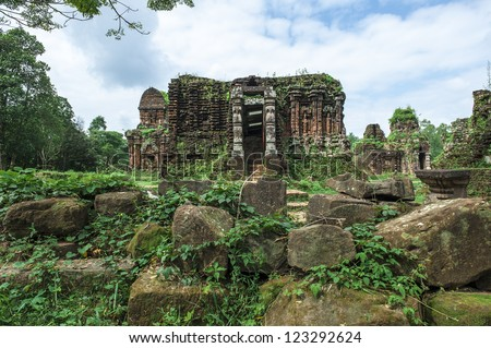 Ruined temple of the ancient Champa at My Son, Da Nang, Vietnam. Those temples (or tomb) with the carved picture of Shiva, the God of Champa,  and the attractive curve into the bricks and stone. - stock photo