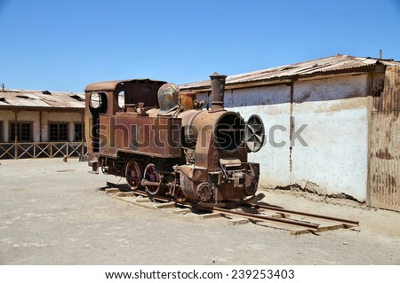Ruined train in deserted ghost town of Humberstone near Iquique, Chile
