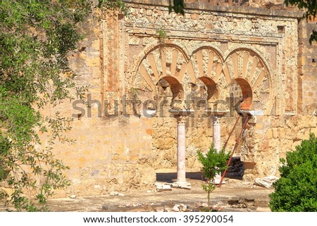 Ruined wall with horseshoe arches of the House of Jafar in Medina Azahara, Cordoba, Andalusia, Spain