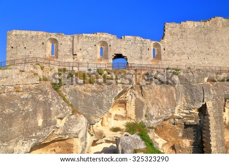 Ruined walls of the medieval fortress in Les Baux de Provence, Provence, France - stock photo