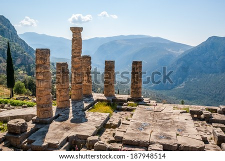 Ruins and columns of an ancient greek temple in front of the surrounding mountains - stock photo