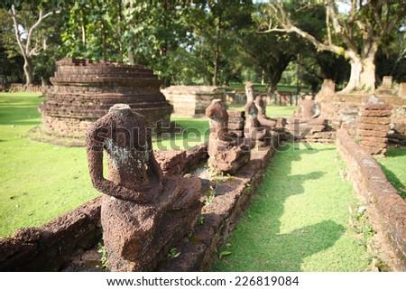 Ruins Buddha image, pagoda, monastery in ancient temple, Kampangphet province northern of Thailand. - stock photo