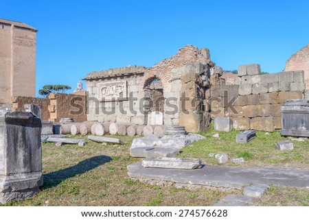 Ruins buildings and statue in the foro romano in Rome italy - stock photo