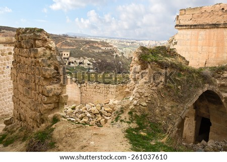 Ruins cave town in Cavusin, Cappadocia, Turkey - stock photo