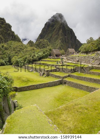 Ruins in Machu Picchu - Mysterious city and archaeological site of pre-Columbian civilization of the Incas on the Andes cordillera mountains archaeology near Cusco, Peru. - stock photo