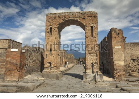 Ruins in Pompeii and in background Vesuvius, Italy - stock photo