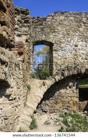 Ruins of a medieval castle on sunny spring day, Nowy Sacz, Poland - stock photo
