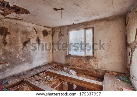 Ruins of a room on the floor with broken floor