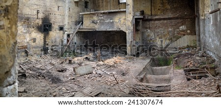 Ruins of a very heavily polluted industrial factory - stock photo