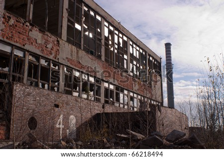 Ruins of a very heavily polluted industrial factory, the place was known as one of the most polluted towns in Europe. - stock photo