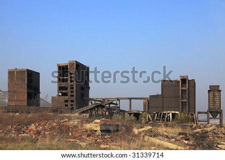 Ruins of a very heavily polluted industrial site at Copsa Mica,Romania.In 1990's the place was known as one of the most polluted towns in Europe. - stock photo