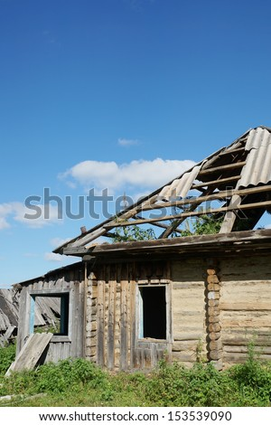 Ruins of an abounded wooden house in a village - stock photo