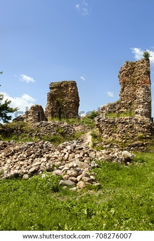 ruins of an ancient fortress destroyed on stones and bricks lying on the ground. Photo of the ruins of Kreva Castle, Belarus