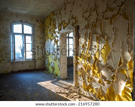 Ruins of an old hospital. Interior old wall with old paint - stock photo