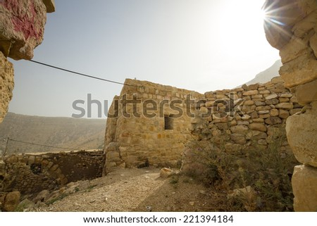 Ruins of an old stone house in the beautiful Dana village in Jordan - stock photo