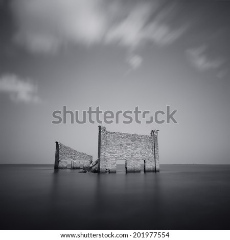 Ruins of an old warehouse in the sea  - stock photo