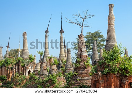 Ruins of ancient Burmese Buddhist pagodas Nyaung Ohak, Shwe Indein, Myanmar (Burma). - stock photo