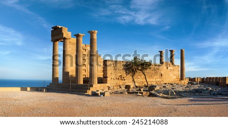 Ruins of ancient Doric temple of Athena Lindia under interesting clouds, Lindos, Rhodes island, Greece - stock photo