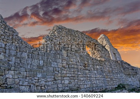 Ruins of ancient fortress wall  in the museum of Chersonesos in Sevastopol town - stock photo