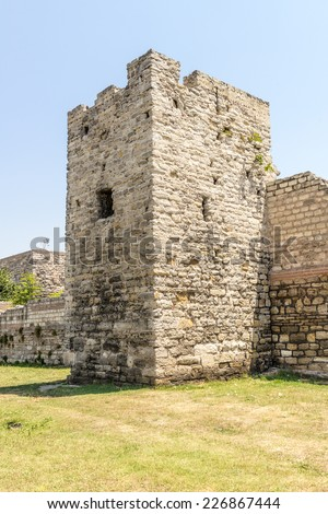 Ruins of ancient fortress wall of the Emperor Theodosius in the center of Istanbul. Turkey - stock photo