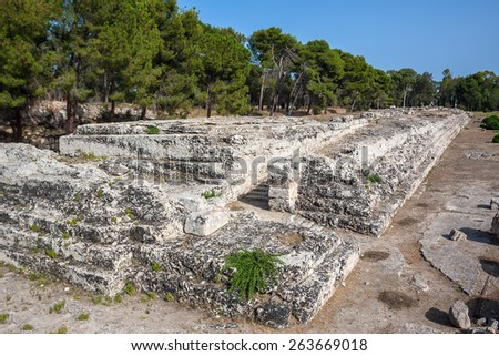 Ruins of ancient Roman amphitheatre in Syracuse, Sicily, Italy - stock photo