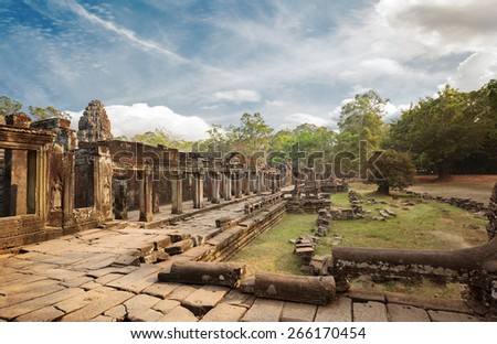 ruins of antique building in archaeological site at angkor - stock photo