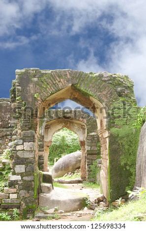 Ruins of Archway in Madan Mahal fort - stock photo