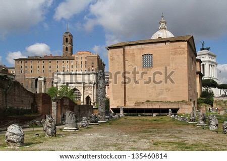Ruins of Basilica Aemilia. The Basilica was 100 meters long and about 30 meters  wide. Along the sides were two orders of 16 arches - stock photo
