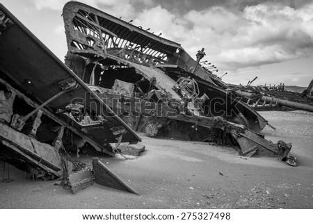 Ruins of British clipper Ambassador on the beach, Estancia San Gregorio, Patagonia, Chile - stock photo