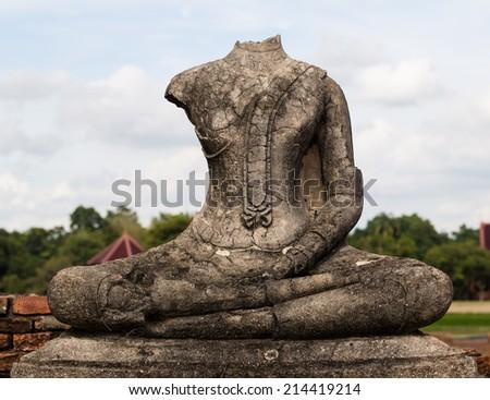 Ruins of buddha statue at Chaiwatthanaram Temple, Ayutthaya - stock photo