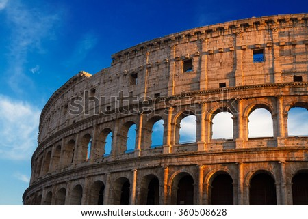 ruins of Colosseum at sunset in Rome, Italy - stock photo