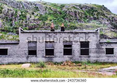 ruins of destroyed an abandoned house - stock photo