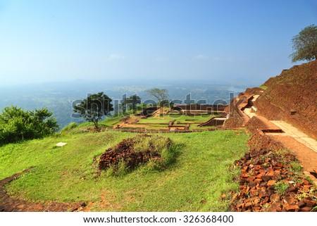 Ruins of fortress on top of Sigiriya Lion Rock, Sri Lanka - stock photo