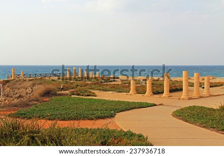 Ruins of Herods promontory palace in Caesarea Maritima National Park, a city and harbor built by Herod the Great about 25-13 BC. The archaeological ruins are on the Mediterranean coast of Israel. - stock photo