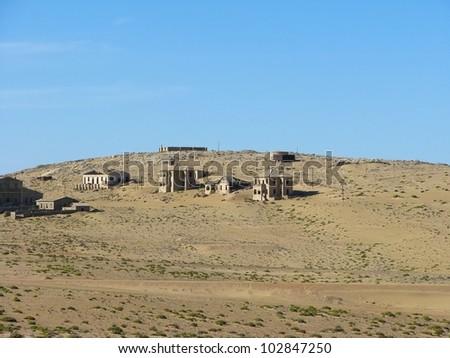 Ruins of houses in ghost town Kolmasnkop, Namibia - stock photo