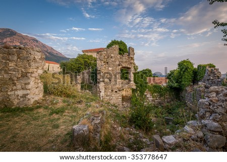 Ruins of medieval fortress tower with windows and destroyed fortification stone walls. Bar, Montenegro.